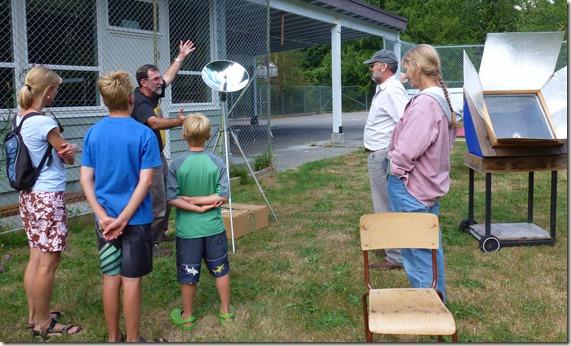 Bruce explaining  a solar parabolic device