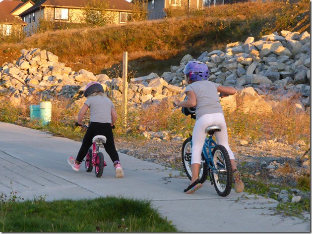 Emma & Brit on bikes - Guenette photo