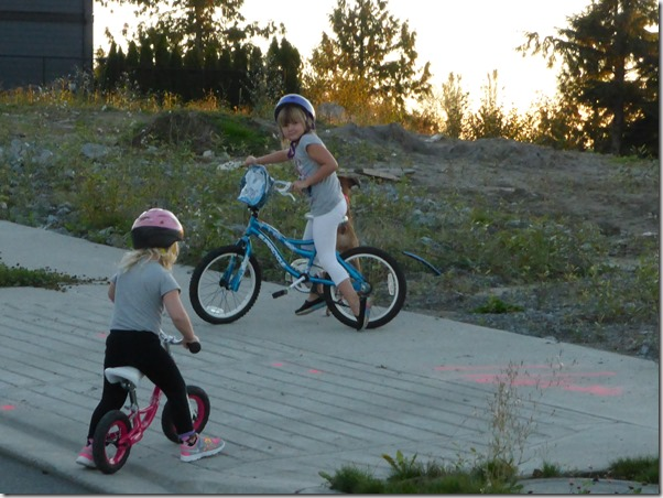 Emma & Brit ride bikes - Guenette photo