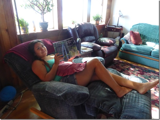 Chelsea relaxing and reading Chasing Down the Night - Guenette photo