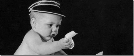 baby in banker's visor - google image