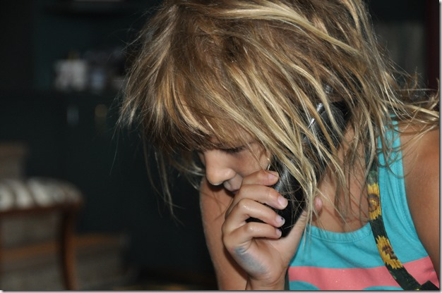 Emma on the phone - Bruce Witzel photo