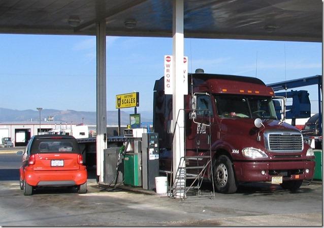 Little car, big truck - Bruce Witzel photo