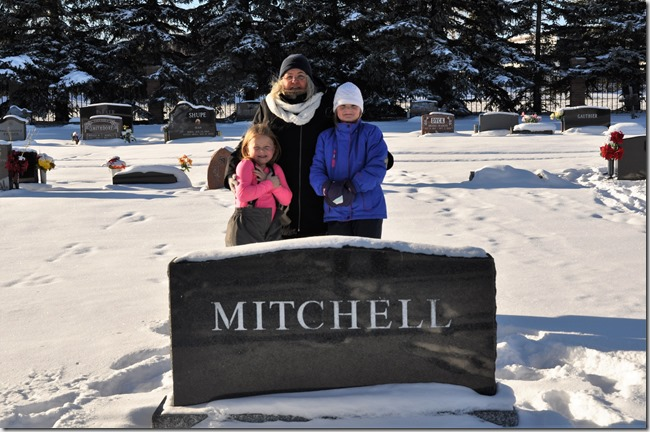 Britney, Grandma & Emma at W.O.Mitchell's headstone in High River cemetary, Jan. 4, 2017 - bruce witzl photo