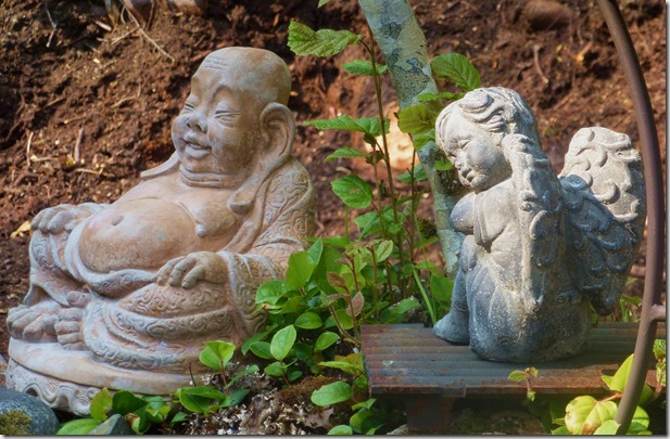 An angel sitting with the Buddha in our garden - photo by Bruce Witzel